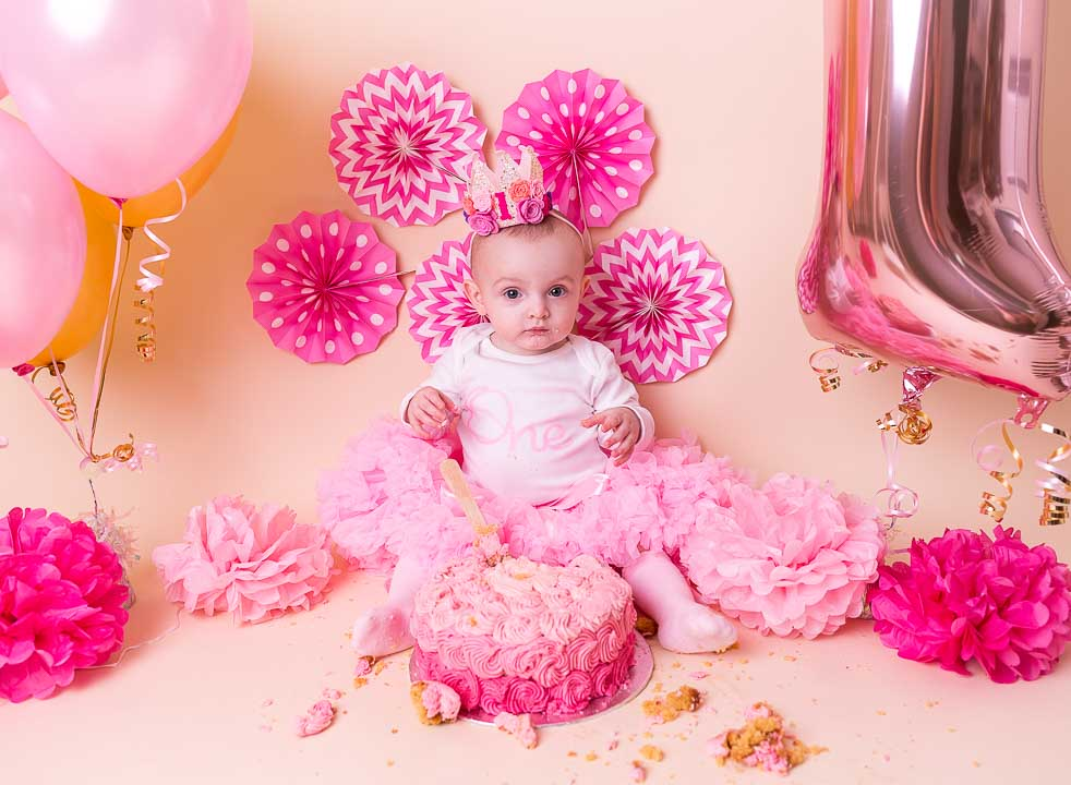 Cake smash 1st Birthday Photos - balloons and baby girl and decorations, the whole set up, all in pink