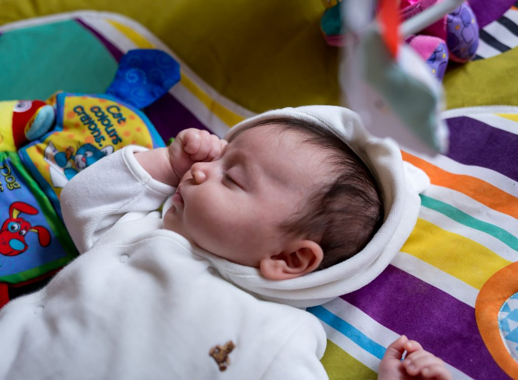 photography of a newborn baby sleeping documentary lifestyle session at family's home Enfield, London