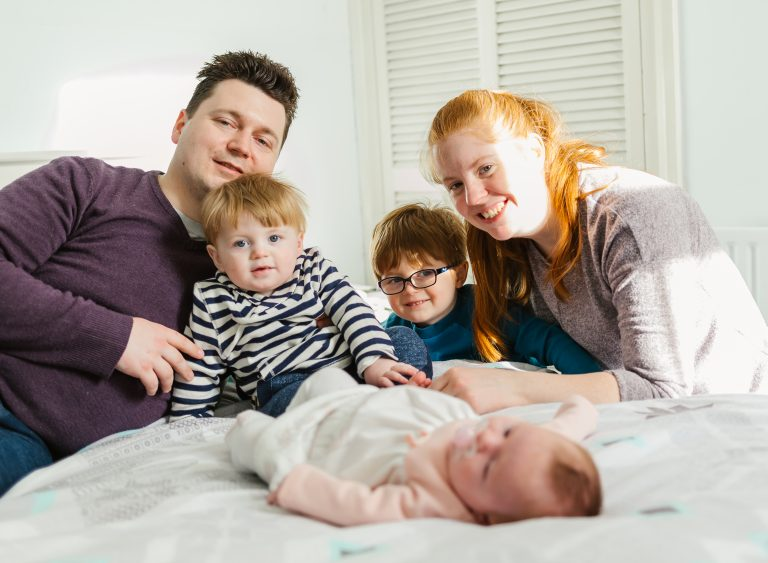 what happens at the home lifestyle photoshoot family posing on the bed