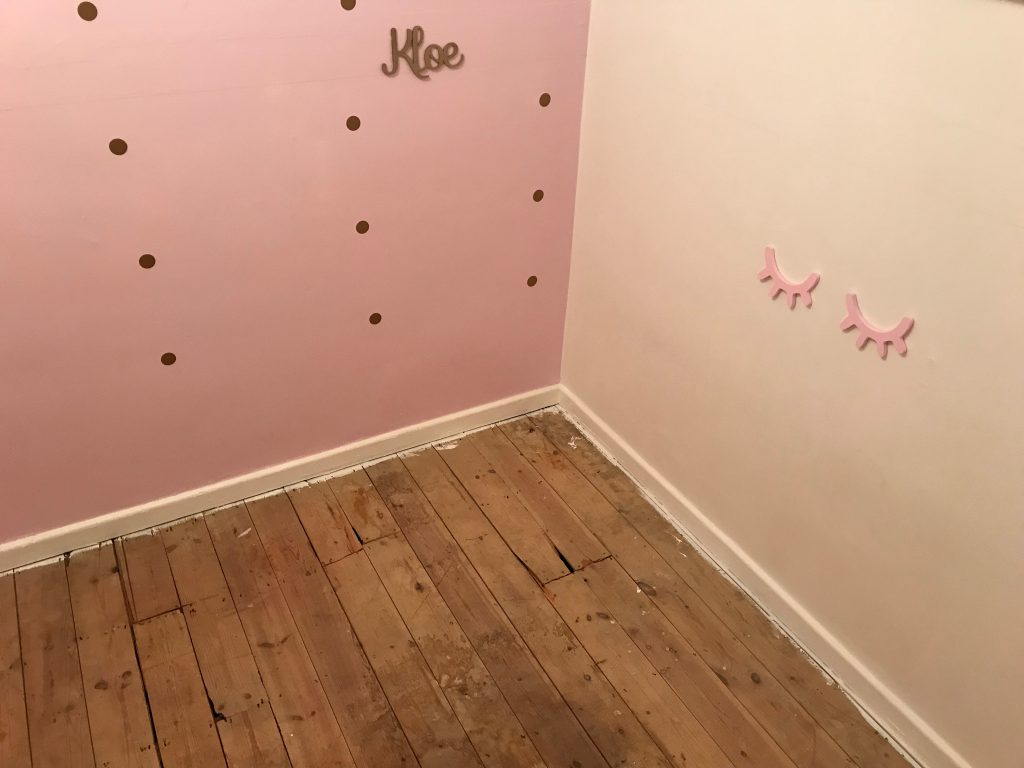 wooden floorboards getting ready for the new carpet pink wall girls room