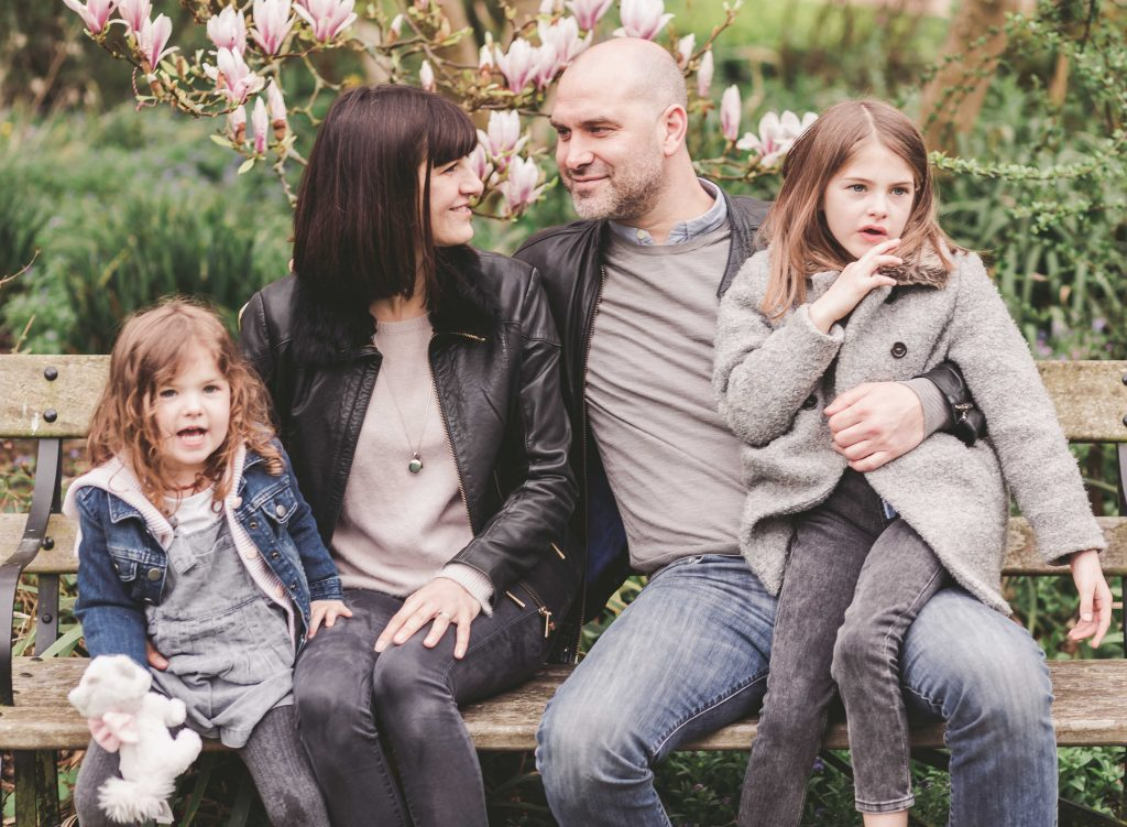 Family of four mum dad sisters siblings sitting in the park Forty Hall Enfield London Photoshoot