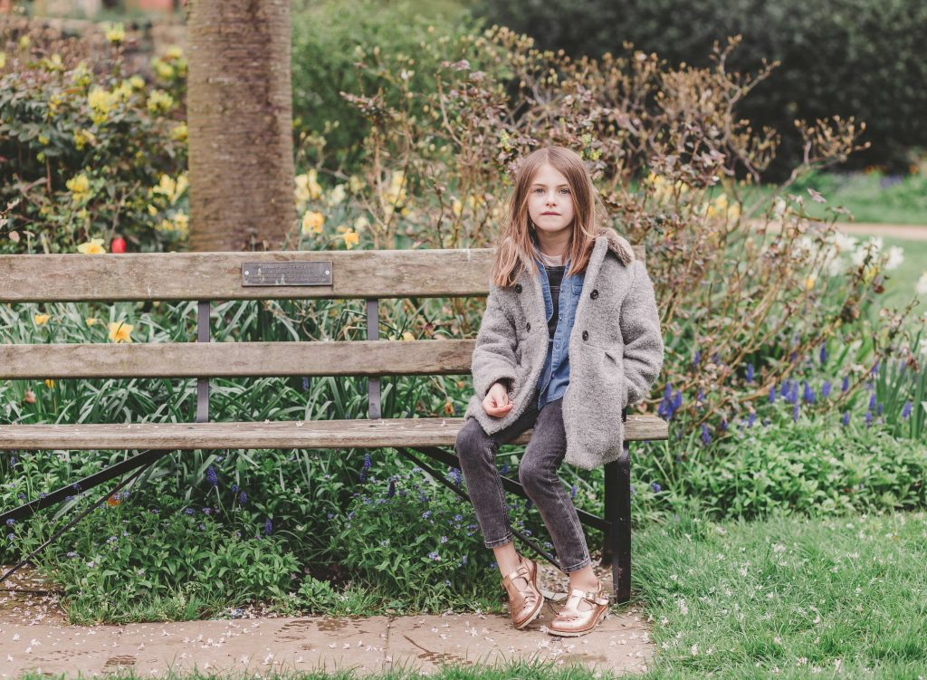 daughter girl sitting in the park Enfield London for the photoshoot