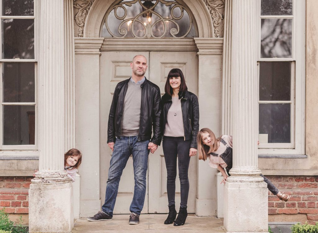 family mum dad daughters standing in front of Forty Hall Enfield London photoshoot London photographer family photoshoot