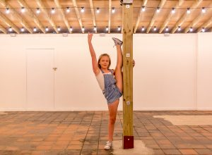 dancing gymnastics standing on one foot near the pool of Camden market of Camden Town London family photographer