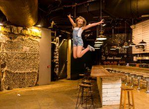 dancing gymnastics jumping off the table Camden market of Camden Town London family photographer