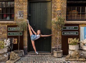 dancing gymnastics in the door of Camden market of Camden Town London family photographer