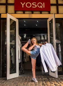dancing gymnastics in the shop window of Camden Town London family photographer